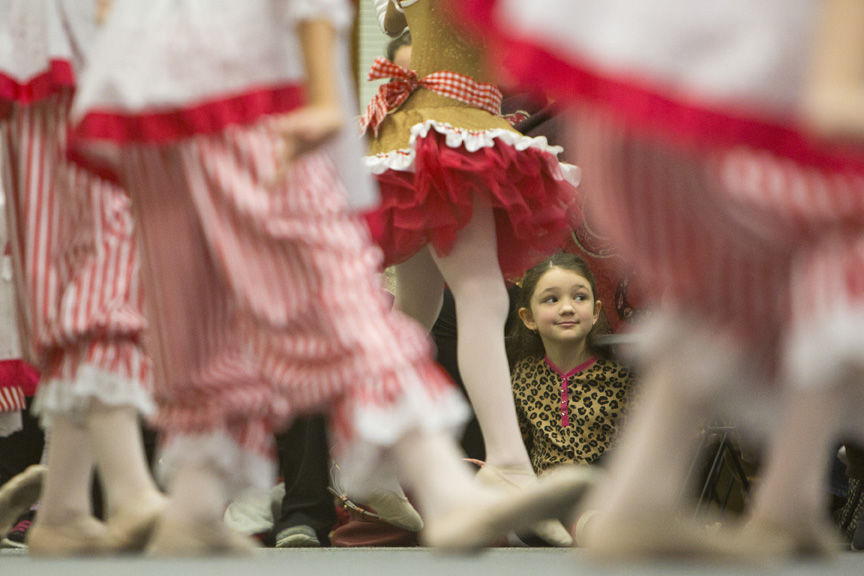 Rachel Scott, 7, looks on as dancers prance across the room Thursday evening during the Eighth Annual Nutcracker Storytime Ballet at the Clara B. Mounce Public Library in Bryan.