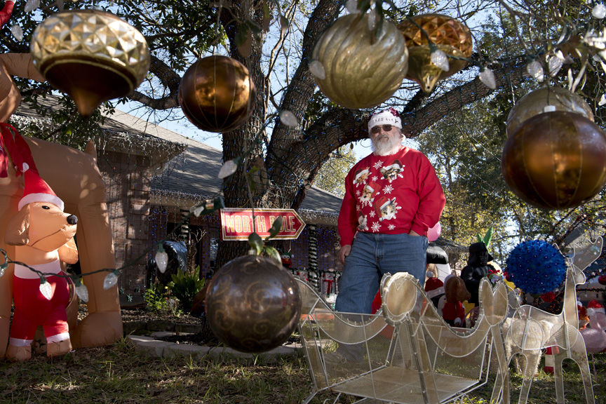 College Station resident Gary Ives shows off his Christmas decorations. Decking the halls � or yard, in Ives� case � began Aug. 1 this year. Ives said he won�t be fully finished with his masterpiece until Dec. 26, but he hopes to have most of the work done by Dec. 20.