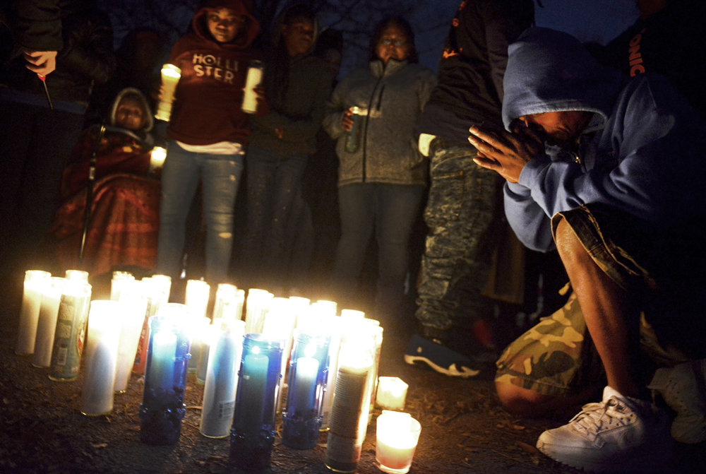 James Lewis, father of 15 year old Cheyenne Vinton, prays at the front of a candlelight vigil held Saturday, January 16, 2016, at 1514 Sycamore St. in Hearne, Texas. On January 15, at approximately 4:10 am, local police were called to the address for a structure fire. Cheyenne Vinton and her mother Wanda Vinton were found deceased in the home after the fire was extinguished.
