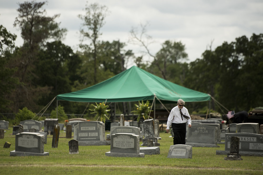 A Liberty County resident who requested to remain anonymous walks away from U.S. Army Sgt. Billy Joe Williams' casket after Sgt. Williams' funeral Tuesday afternoon, May 17, 2016, at the cemetery outside Rock Prairie Church in Madisonville, Texas.
