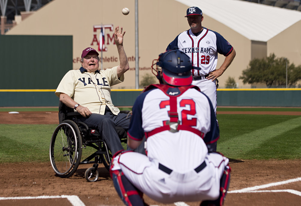 Former President George H. W. Bush throws out the opening pitch to Texas A&M player Stephen Kolek, Saturday, March 5, 2016, at Olsen Field at Blue Bell Park, in College Station, Texas.