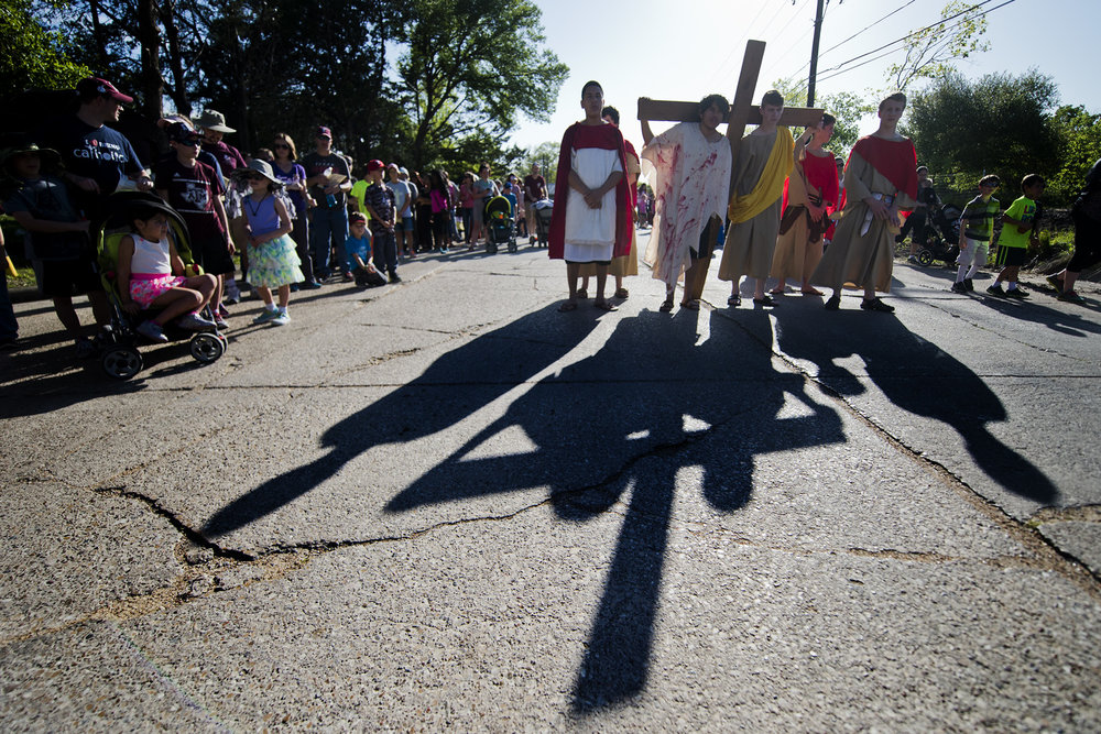 Saint Anthony's Catholic Church members move through the neighborhoods North of the church as they play out the 14 Stations of the Cross, Friday, March 25, 2016, in Bryan, Texas.