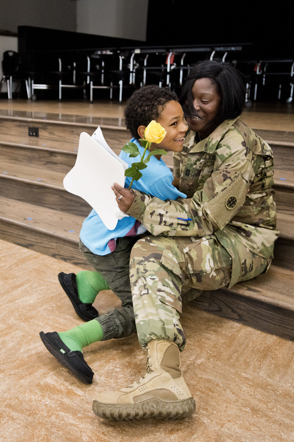 "Spring Creek Elementary second grader Texas Redwine, 8, embraces with his mother, U.S. Army Reserve Capt. Jamesia Redwine during her surprise visit to the school during their ""Superhero Day,"" Friday afternoon, May 13, 2016, in College Station, Texas. Capt. Redwine has been on deployment since June of 2015."