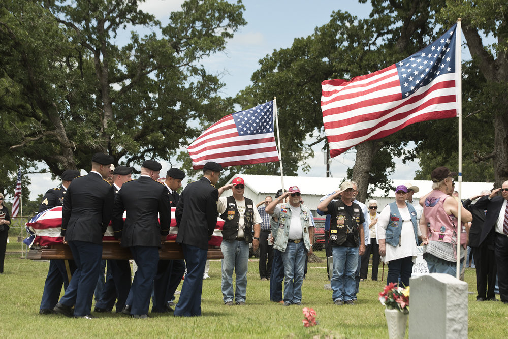 U.S. Army Sgt. Billy Joe Williams' casket is carried to his grave by men of the U.S. Army C Battery FAS 3rd Calvary Regiment Tuesday afternoon, May 17, 2016, at the cemetery outside Rock Prairie Church in Madisonville, Texas.