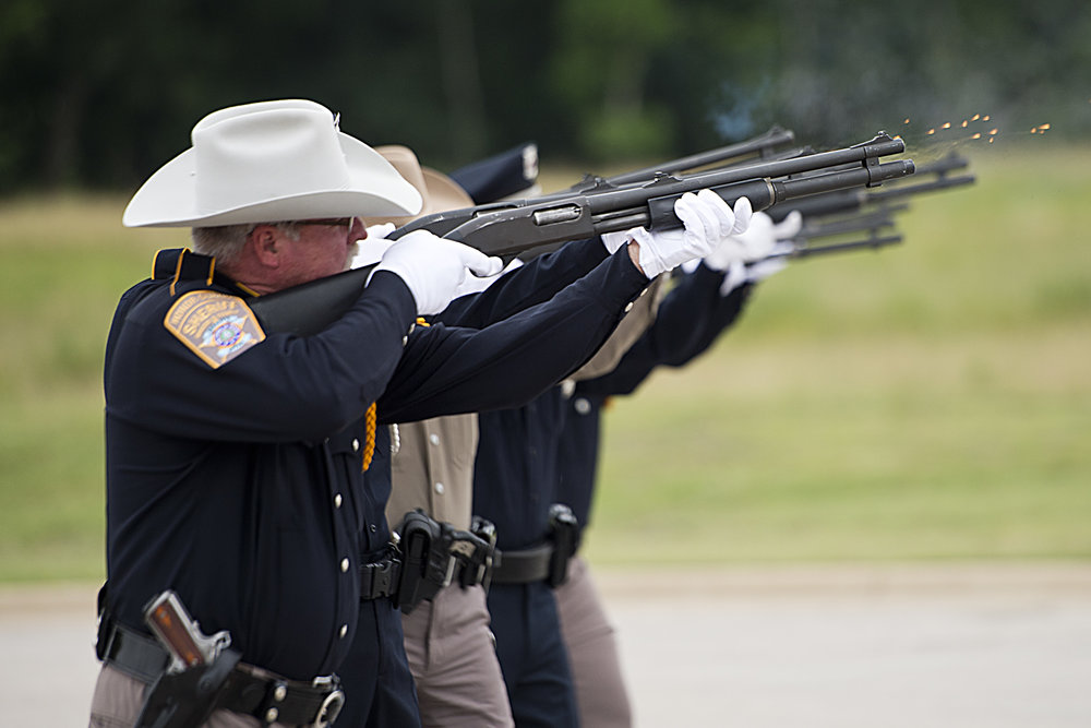 Brazos County Sheriff Department deputy Bill Kristof fires with the other members of the fire team during the 21-gun salute, Wednesday, May 18, 2016, at the 29th Annual Law Enforcement Memorial Service at Veterans Park and Athletic Complex in College Station, Texas.