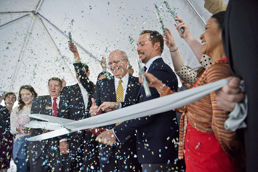 Midway development company CEO Jonathan Brinsden cuts the ceremonial ribbon while others throw confetti to celebrate the opening of the Century Square apartment building, Wednesday, Nov. 16, 2016, off University Drive in College Station, Texas.