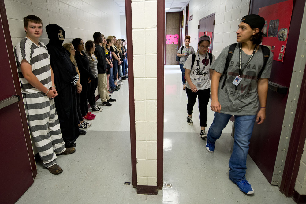 A&M Consolidated High School junior Johnathen Perez, right, does a double-take on a group of students participating in the Shattered Dreams program, Tuesday, April 19, 2016, at A&M Consolidated High School in College Station, Texas.