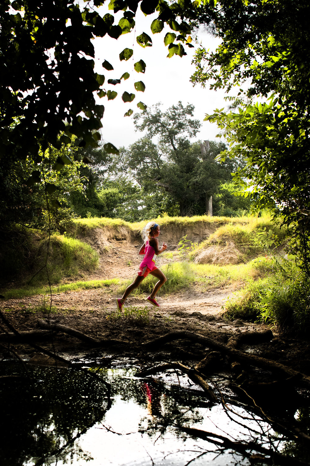 "Cjloe Murr, 9, runs past Still Creek while leading her age group in the Still Creek Ranch ""Dash the Creek 5k"" race Saturday, July 16, 2016, in Bryan, Texas."
