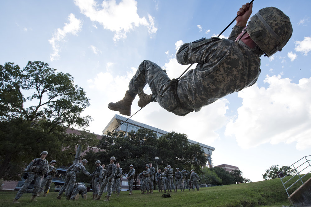 Texas A&M sophomore construction science major Andrew Lichtenauer zips his way across the creek in Spence Park while other Corp of Cadets members look on Tuesday, Sept. 6, 2016 in College Station, Texas. These Cadets will be participating in this year's ROTC Ranger Challenge, a competitive event that has national ROTC groups compete in various military drills.