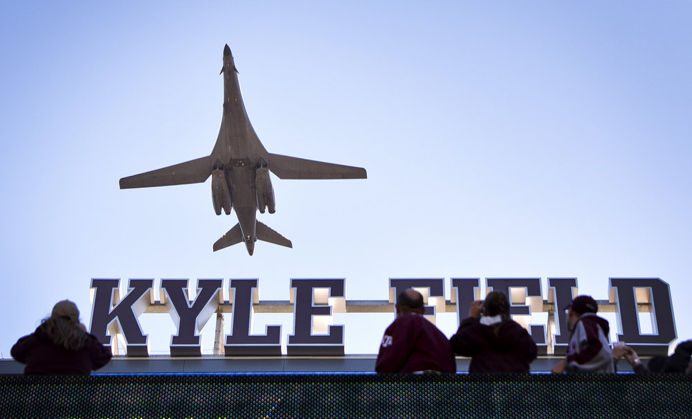 A B-1B Lancer bomber out of Dyess Air Force Base in Abilene, Texas flies over Kyle Field before a football game between Texas A&M University and the University of Texas at San Antonio, Saturday morning, Nov. 19, 2016, in College Station, Texas.