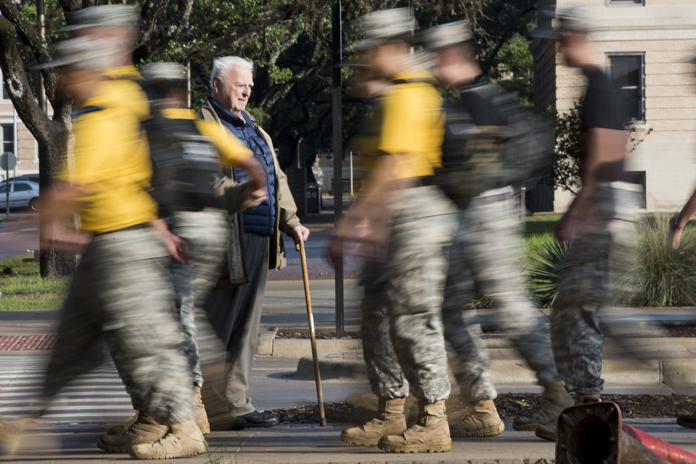 "College Station Resident Albert Bradley, 81, shakes as many hands as he can as the Corp of Cadets march out of The Quad on Texas A&M's campus for their March for the Brazos, Saturday morning, April 30, 2016, in College Station, Texas. Bradley has been working with the Corp of Cadets for around 45 years. ""They all know me in The Corp,"" he said. ""When I had my house, some of them even lived with me."" Bradley even garnered a big hug from one cadet on his march."
