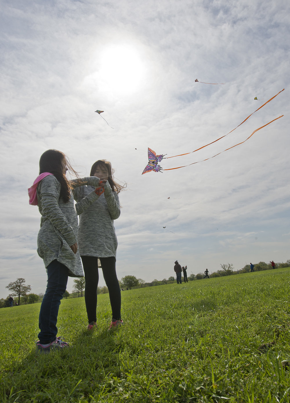 Sisters, from left, Aiyana and Riena Mishima work together to let a little slack out for their kite during a kite flying contest put on by local radio station PEACE 107.7, Saturday morning, March 19, 2016, at the George Bush Presidential Library and Museum in College Station, Texas.