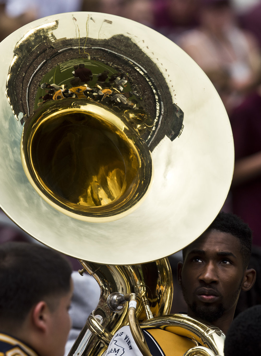 Kyle Field is reflected in the sousaphone of a Prairie View A&M University marching band member before taking the field for their halftime performance, Saturday, Sept. 10, 2016, in College Station, Texas.