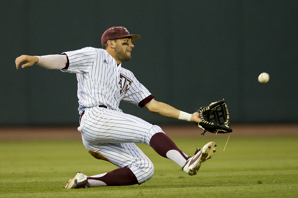 Texas A&M University outfielder J.B. Moss (11) slides in to catch a ball hit by Sam Houston State University's Zach Smith, not pictured, during game played Tuesday night, May 17, 2016, at Blue Bell Park in College Station, Texas.