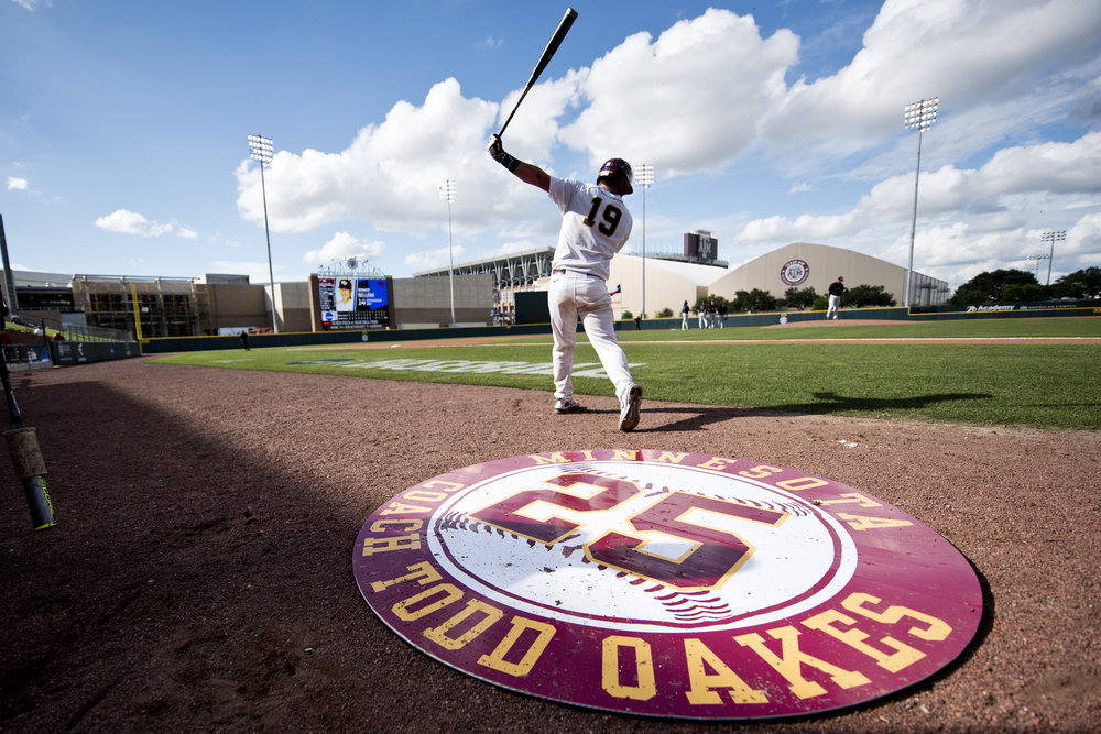 University of Minnesota catcher Austin Athmann doesn't step on the on-deck circle that Texas A&M University had made in honor of Minnesota pitching coach Todd Oakes, who recently passed away, during a NCAA D1 College Station Regional game against Wake Forest, Friday, June 3, 2016, at Blue Bell Park in College Station, Texas.