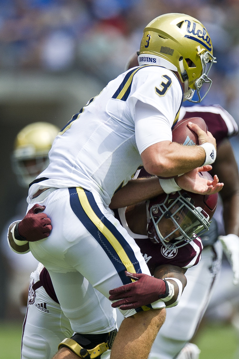 Texas A&M University defensive back Armani Watts (23) sacks UCLA quarterback Josh Rosen (3) during Texas A&M University's season opening home game against the UCLA, Saturday, Sept. 3, 2016, at Kyle Field in College Station, Texas.