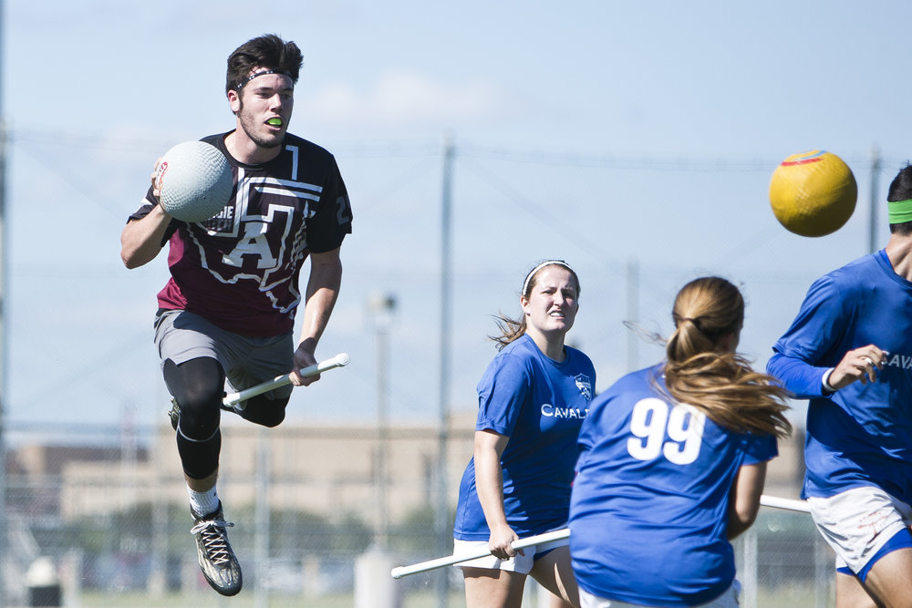 Texas A&M Quidditch beater Harris Coleman (25) attempts to knock a Cavalry chaser out Saturday afternoon, Oct. 15, 2016, at the 4th A&M Classic Quidditch tournament in College Station, Texas.