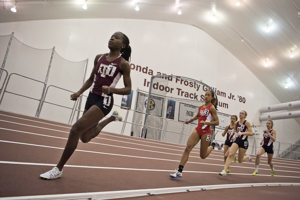 Texas A&M sophomore Jazmine Fray, left, competes in the women's 100 meter run during a track meet Saturday, Dec. 10, 2016, at the Gilliam Indoor Track Stadium in College Station, Texas.