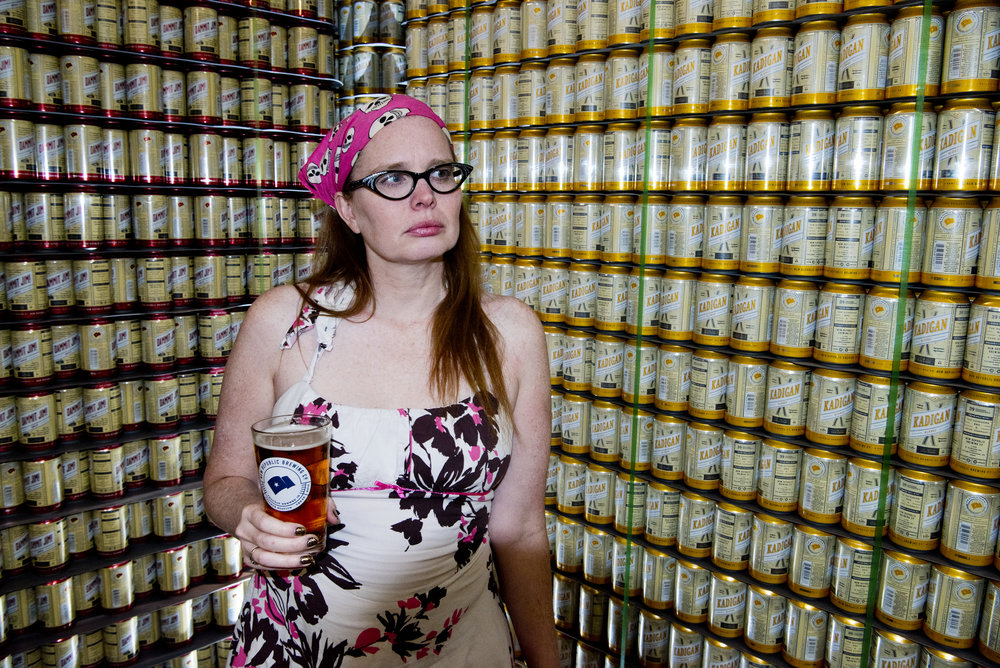 Texas A&M Forensic Entomology professor and co-owner of Rew Republic Brewing Adrienne Brundage poses in front a empty cans stacked in the back room of New Republic Brewing, Friday afternoon, Feb. 19, 2016, in College Station, Texas