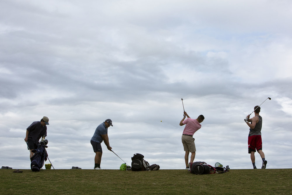 Students practice on the driving range during a session of the Beginning Golf II class, Wednesday, March 8, 2017,  at the driving range on The Campus Course at Texas A&M in College Station, Texas.
