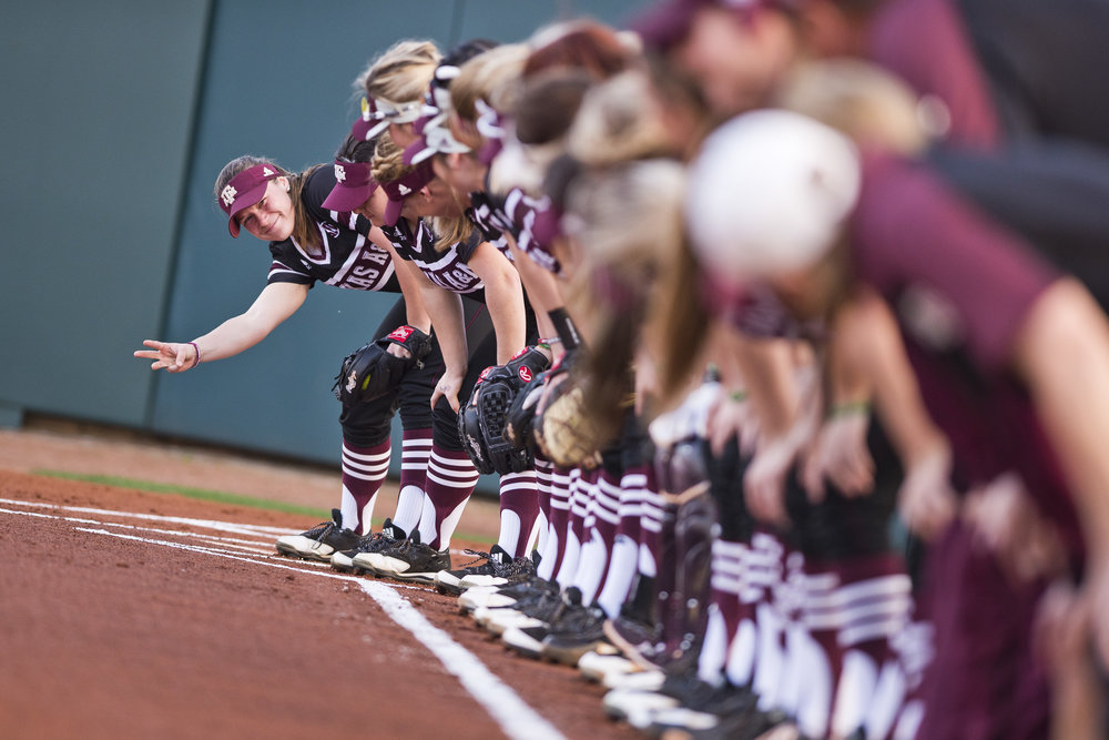 Texas A&M junior outfielder Erica Russell (3) counts to three, signaling to her teammates when to yell in unison before their season-opening game against Lamar University, Friday, Feb. 10, 2017, in College Station, Texas.