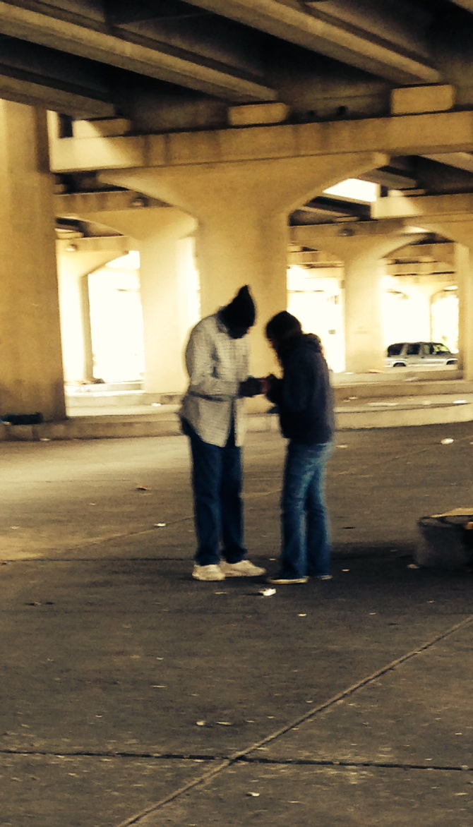 Our founder, Kim, praying with one of our homeless guests attending the first outreach event in October 2013.