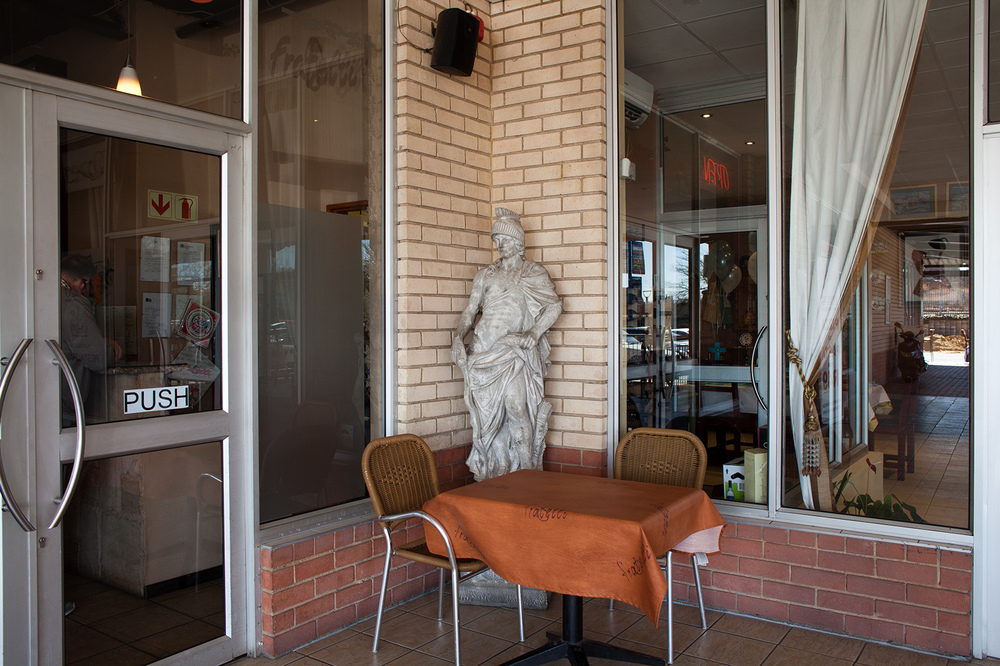 "26°04'54.0""S 27°59'53.4""E ,  20/07/2014, 1201 Statue, 1920 Portuguese restaurant, Randburg, Johannesburg, South Africa"