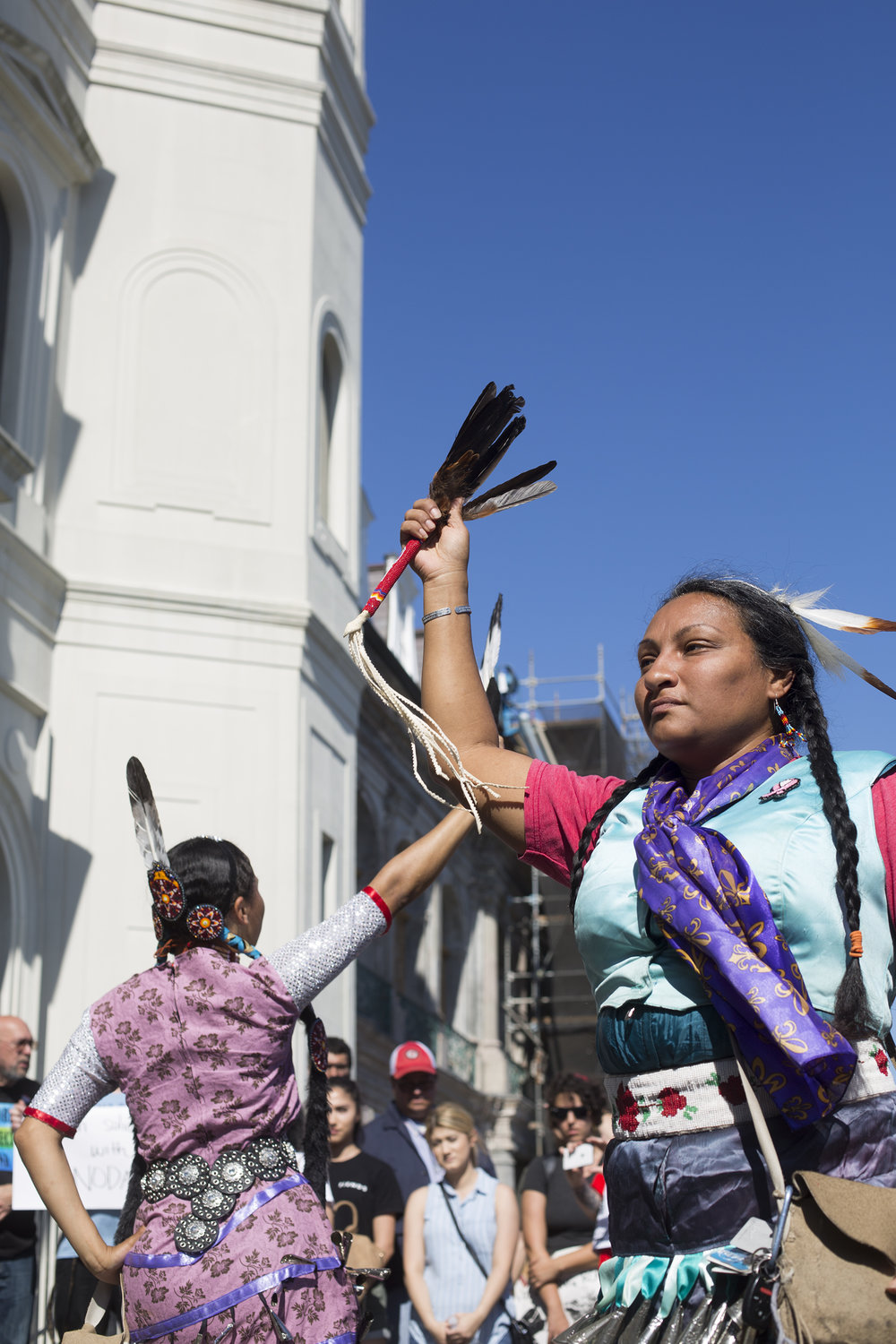 Nina Martinez, right, and Scierra LeGarde performing a ceremonial dance.
