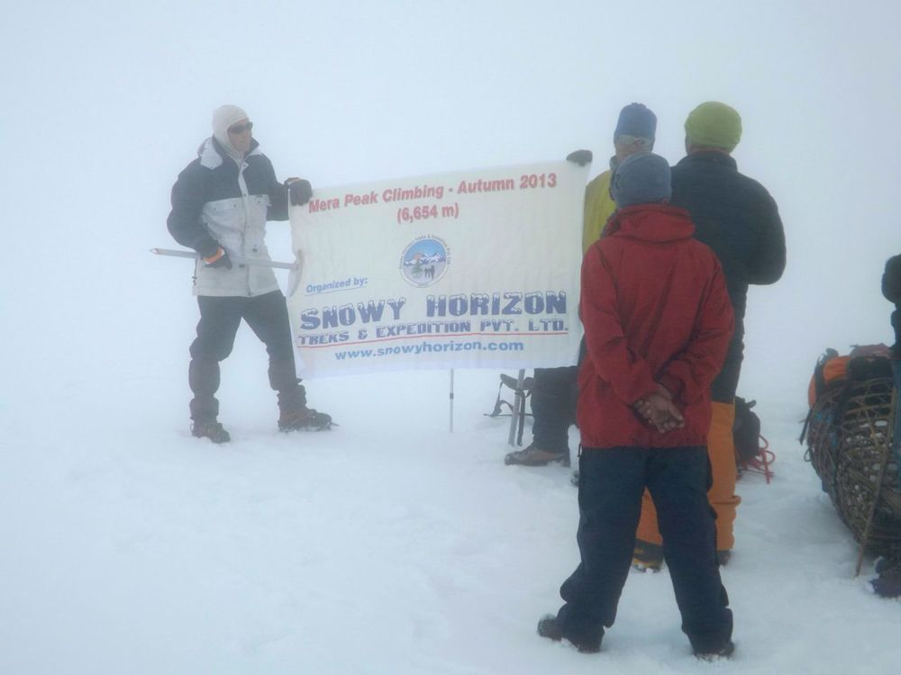 We were in a cloud with snow, could not find the high camp. We contempleted the situation and decided to take safety first – we turned back from about 5900m.