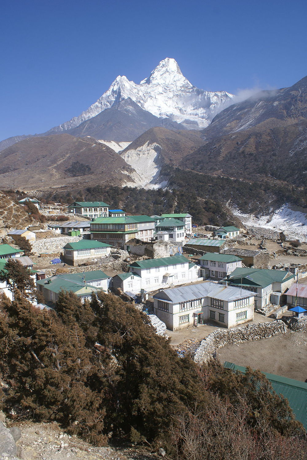 By Moralist (Own work) [CC-BY-SA-3.0 (http://creativecommons.org/licenses/by-sa/3.0)], via Wikimedia Commons. A view of the Pangboche village with Ama Dablam behind.