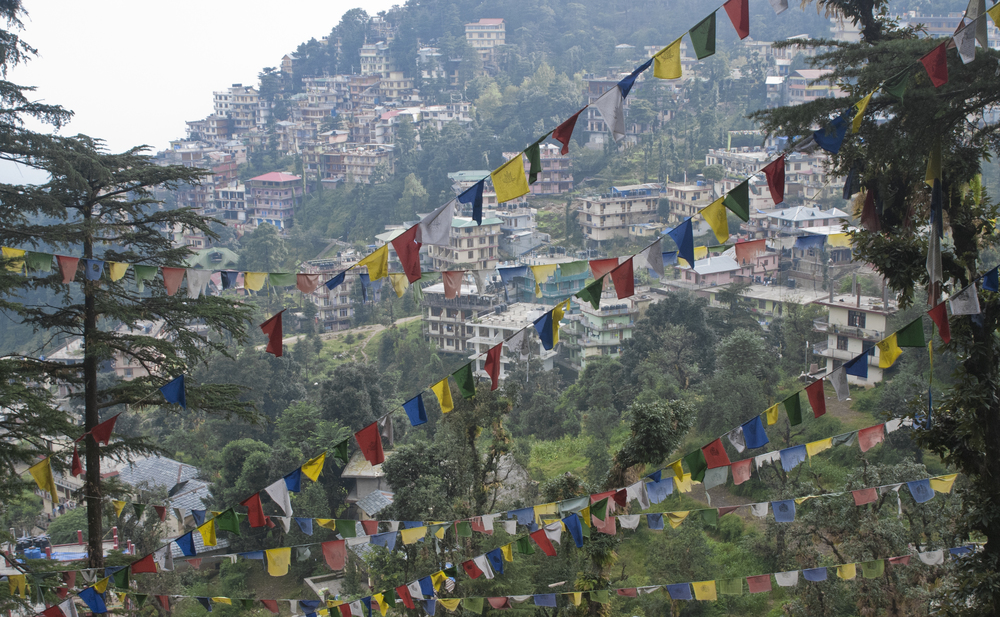 Buddhist prayer flags decorate the mountainside
