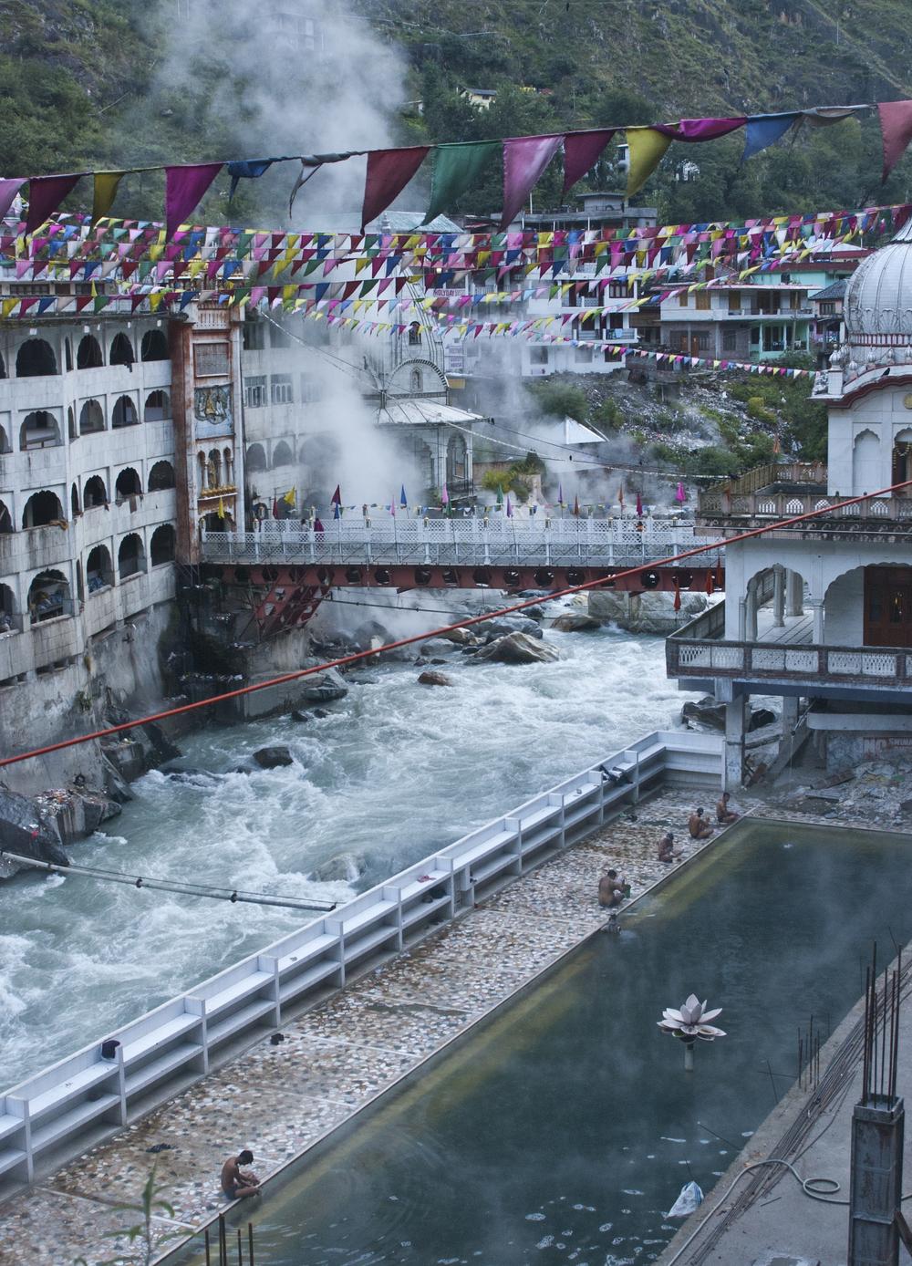 Pilgrims bathe in the hot springs of Manikaran next to the roaring Parvati River.