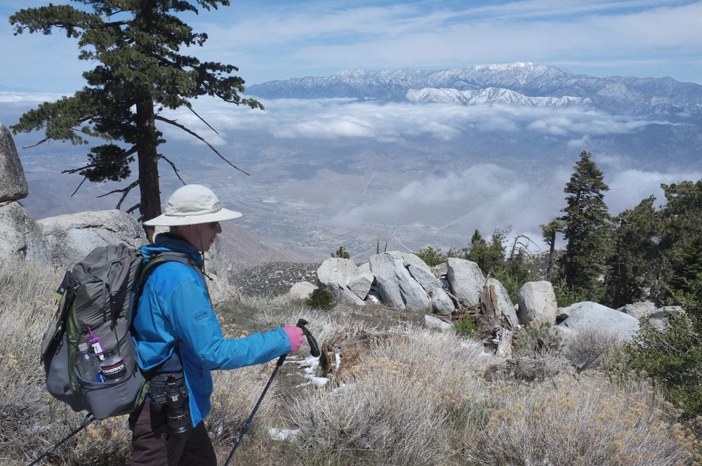 Jonathan descending, seeking warmer climbs.