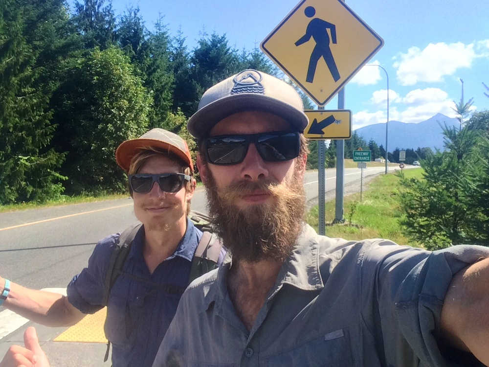 Sick Soapbox and trusty friend, Pedi hitching to get back to the trail from North Bend.