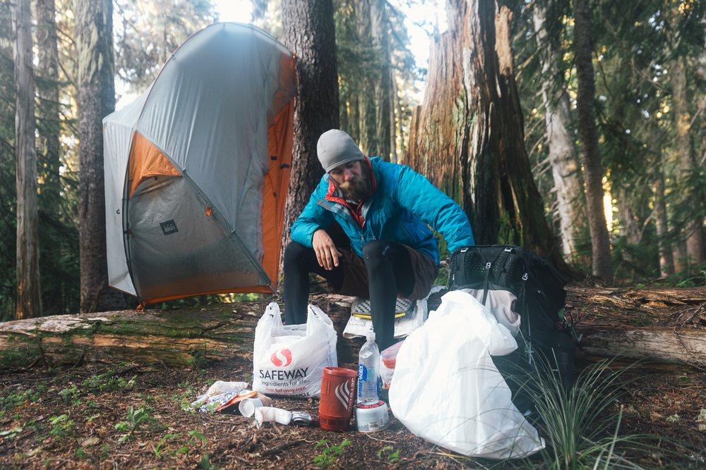 Dan decided to hang up his tent to let it dry while he ate breakfast. Who does that?