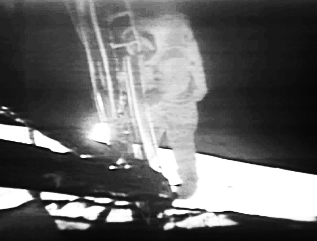 Neil Armstrong first steps on the Moon shown live on TV