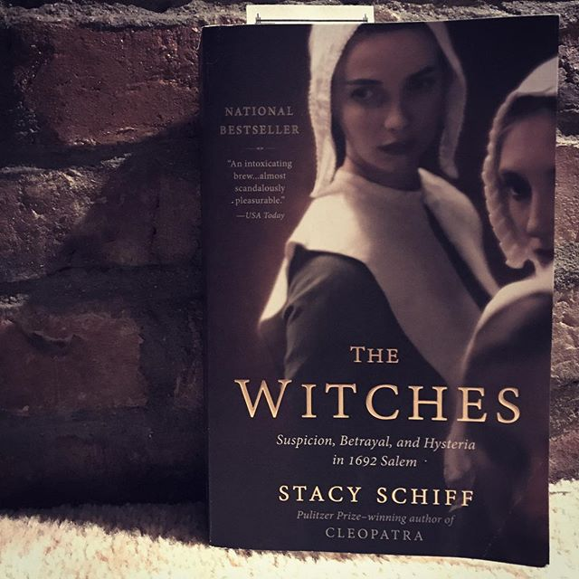 """Witches had troubled New England since its founding. They drowned oxen, caused cattle to leap four feet from the ground, tossed skillets into the fire, tipped hay from wagons, enchanted beer, sent pails crashing and kettles dancing. They launched apples, chairs, embers, candlesticks, dung through the air. They sent forth disembodied creatures, in one case a man's head connected to a white cat tail by several feet of nothingness—a Cheshire Cat centuries before Lewis Carroll."" #Halloween #amreading #booksofinstagram #bookphotography #witches #salem #Halloweenreading #stacyschiffthewitches #stacyschiff #thewitches #salemwitchtrials"