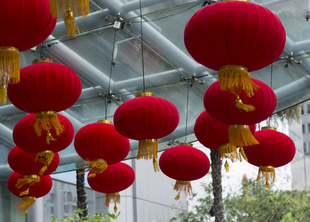 Red Lanterns © Naida Ginnane 2018, Nikon D800, Nikkor 85mm lens  Case in point, the outside portico of a hotel in Singapore, preparing for Chinese New Year. The lanterns are so vibrant and the wind created some movement in the tassles, which I think is preferable to them hanging still.
