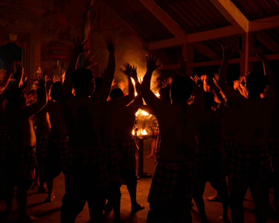 'Body Frame' © Naida Ginnane 2016 Nikon D800, 24-70mm lens f/2.8, 1/15, ISO 800  The dancers' bodies are used to frame the central flame lamp- even if just for a split second, we get a glimpse into a hidden world.