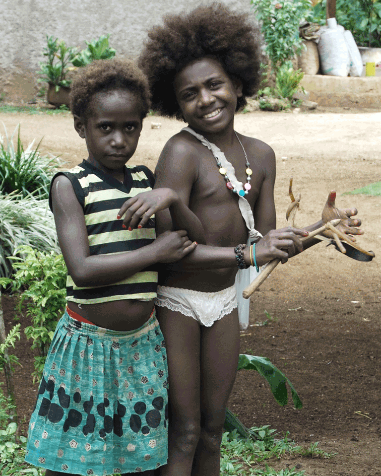 Two Girls Vanuatu' © Naida Ginnane 2013 Nikon D40, f/10, 1/250, ISO 100. I was in the back of a car on the way to the jungle when we passed these two sweet girls.