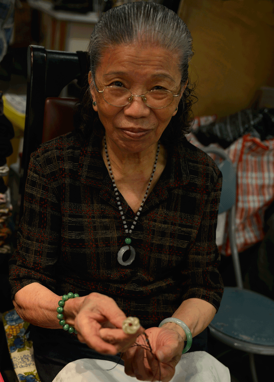 'Jade Seller' © Naida Ginnane 2016 Nikon D800, 24-70mm lens f/6.3, 1/250, ISO 100. I took an interest in this lady and her market stall, as a result, she was very pleased to show me how she makes her bracelets.