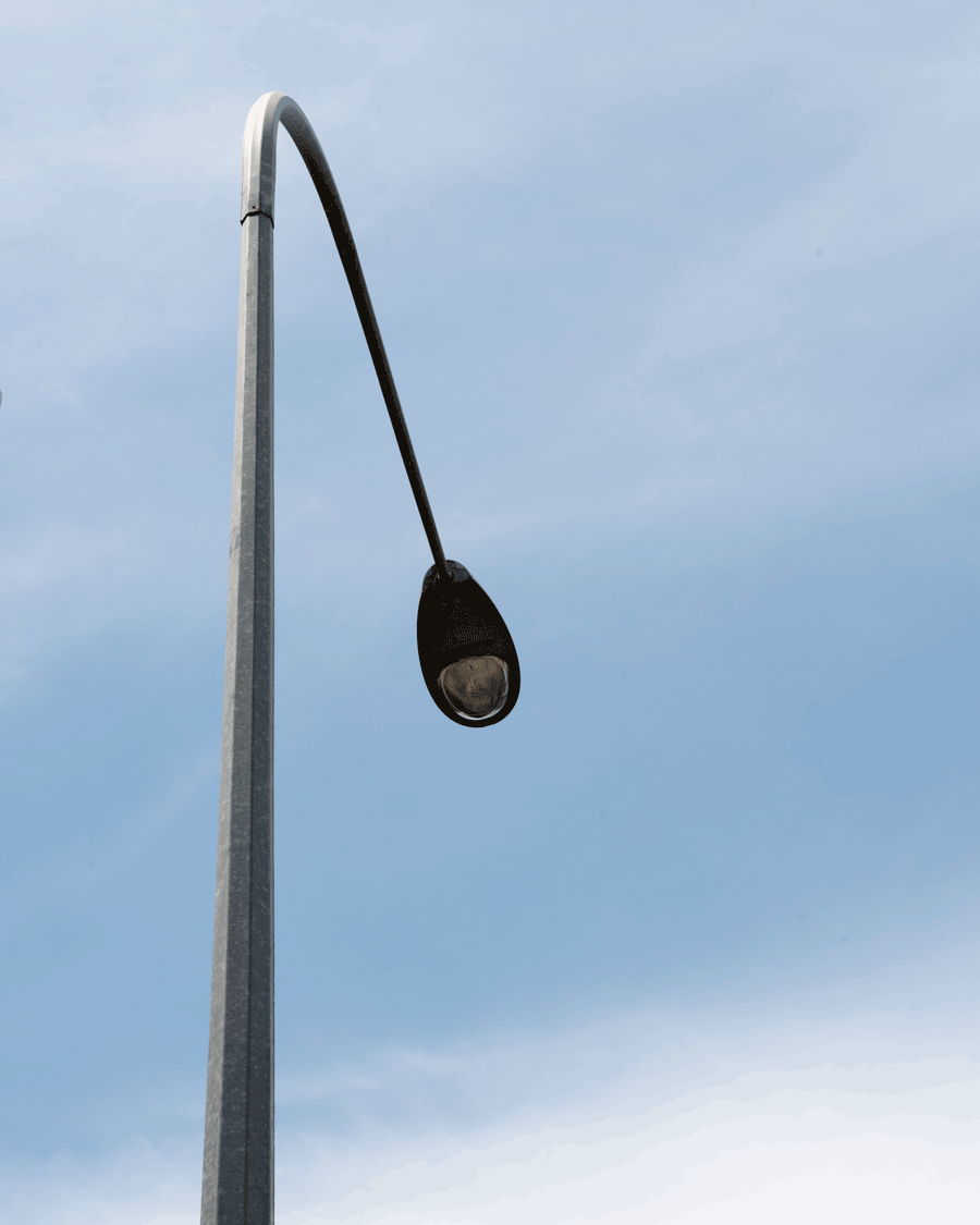 'Line' © 2018 Naida Ginnane Nikon D800 24-70mm lens f/ 7.1, 1/320, ISO 125. The beautiful simplicity of this light pole set against the slight variations in the sky create a very strong minimalist image.