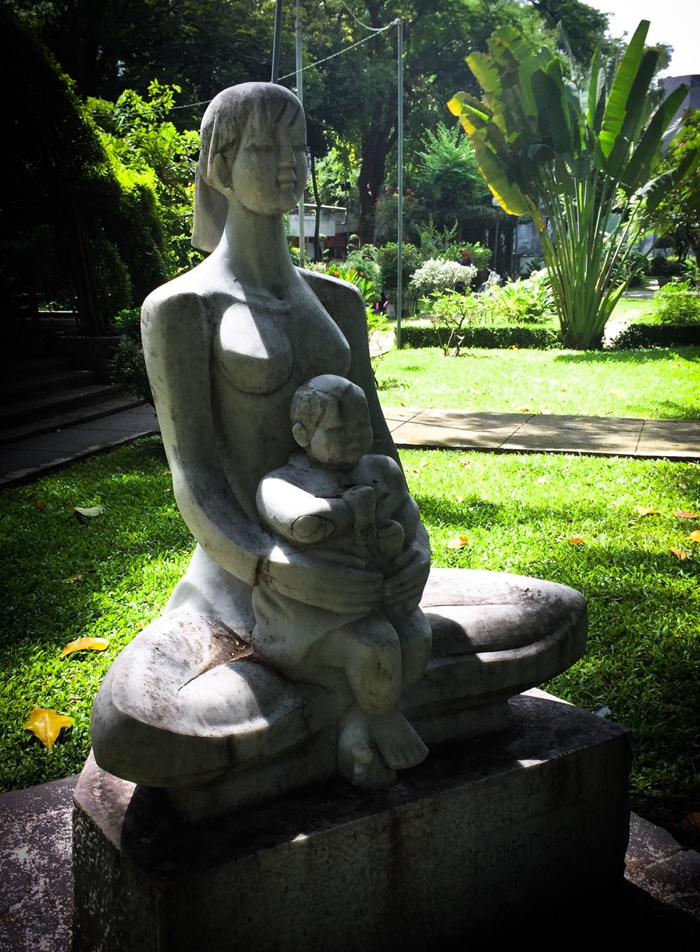 'Mother & Child' © Naida Ginnane 2017 iPhone 6s. A stone sculpture in a Vietnamese park acts as a symbol of peace representing the ideas of love and family.