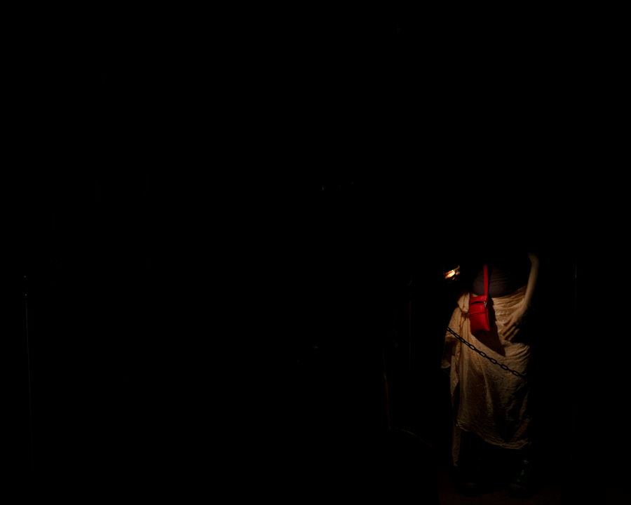 'Who Am I?' © Naida Ginnane 2018 Nikon D800 24-200mm lens 1/40, f/13, ISO 100. This partial figure appearing out of the darkness suggests an incomplete identity. Darkness symbolises the 'unknown' and as we see tiny details of this person's hand and clothing we understand that some parts are known and others are yet to be.