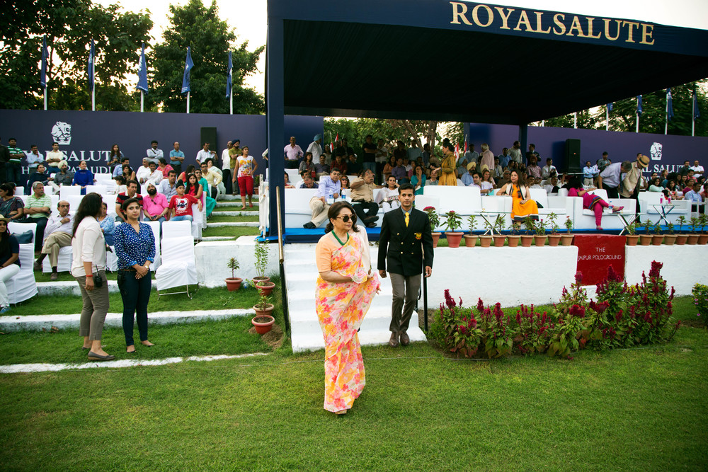 Host Sharmila Tagore about to hand over the ball to the teams, indicating the start of the play