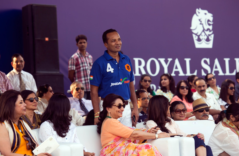 Naveen Jindal and Sharmila Tagore engrossed in the action packed match.