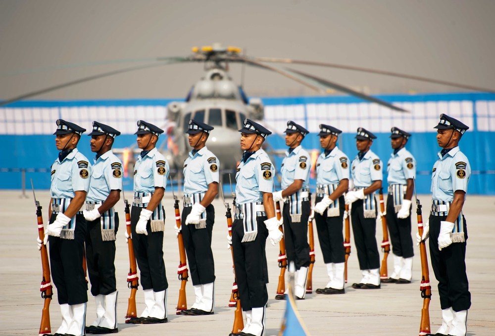 Airforce Personnel doing tricks with their guns