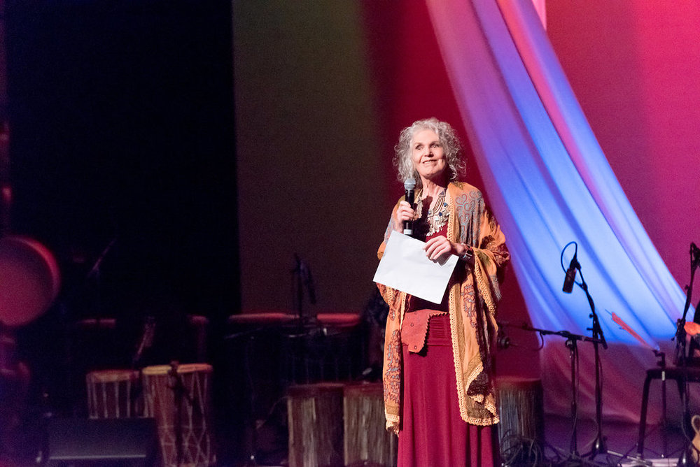 Asheville RHythm's Outreach Director, Rima Luna, emceeing