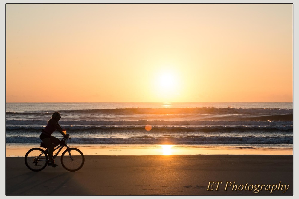 Sunrise bike rider