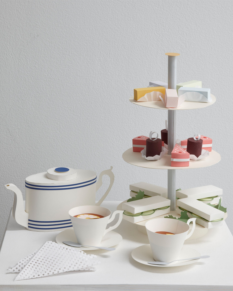 afternoon tea set with cake and cucumber sandwiches